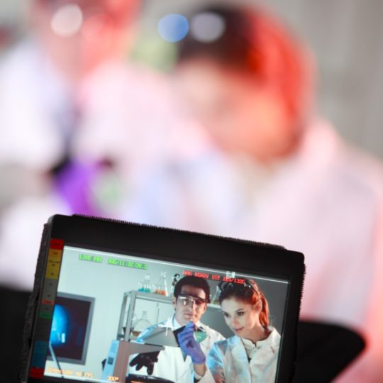 A Top Pup Media medical video production professional films two medical lab assistants in the lab.